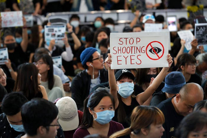 Teenage boy shot after Hong Kong imposes a ban on protesters wearing mask